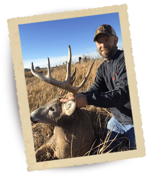 Hunter with Deer in Field